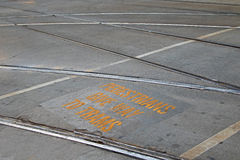 """Tramway with yellow signage """"Pedestrians give way to trams"""" Royalty Free Stock Photo"""