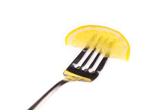 Tranche de citron sur la fourchette Images stock