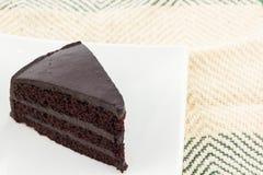 Tranche de gâteau de chocolat Images stock