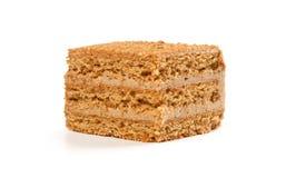 Tranche de gâteau de miel posé Photos libres de droits