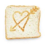 Tranche de pain avec le coeur et la flèche Images libres de droits