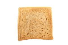 Tranche de pain sur le fond blanc Photos stock