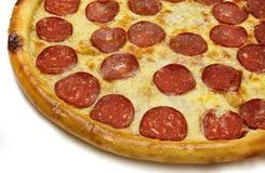 Tranche de pepperoni de pizza Photos libres de droits