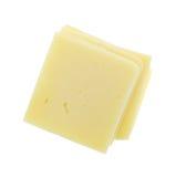 Tranches carrées de fromage de cheddar sur le fond blanc Photo stock