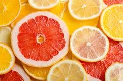 Tranches d'agrumes de citron, orange, pamplemousse pour le fond Photographie stock