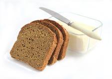 Tranches de pain et de beurre de seigle Photographie stock