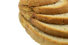 Tranches de pain sur le fond blanc images stock