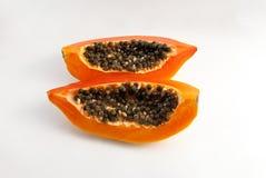 Tranches de papaye douce sur le fond blanc Images stock