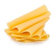 Tranches de plan rapproché de fromage d'isolement sur un fond blanc Photo libre de droits