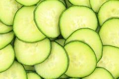 Tranches de texture verte fraîche de fond de nourriture de concombres Photo libre de droits