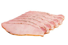 Tranches fumées de filet de porc d'isolement sur le blanc Image libre de droits