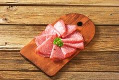 Tranches minces de salami Photographie stock libre de droits