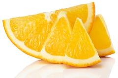 Tranches oranges d'isolement sur le fond blanc Photographie stock libre de droits