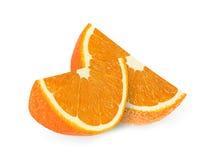 Tranches oranges de fruit d'isolement sur un fond blanc Image libre de droits