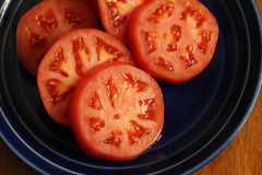 Tranches rondes de tomate Images stock