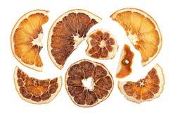 Tranches sèches d'oranges d'isolement sur le fond blanc Image libre de droits