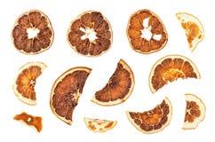 Tranches sèches d'oranges d'isolement sur le fond blanc Photographie stock libre de droits