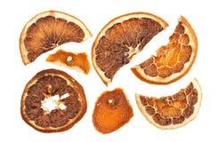 Tranches sèches d'oranges d'isolement sur le fond blanc Image stock