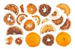 Tranches sèches d'oranges d'isolement sur le fond blanc Photographie stock