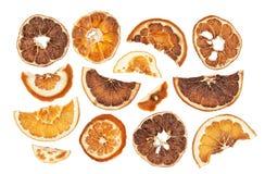 Tranches sèches d'oranges d'isolement sur le fond blanc Photos libres de droits