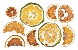 Tranches sèches d'oranges d'isolement sur le fond blanc Photos stock