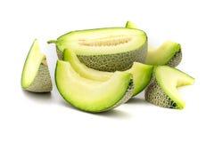 Tranches vertes de melon d'isolement sur le fond blanc photographie stock libre de droits