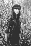 Trandy style portrait of young  girl in fashionable hat and leather jacket. Black and white portrait outdoor Royalty Free Stock Photo
