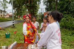 Chinese god spiritual medium blessing people during vegetable festival in Trang, Thailand. Trang, Thailand - October 15, 2018: Chinese god spiritual medium stock photo