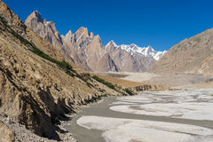 Trango tower family, Lobsang spire and river, K2 trek, Pakistan. Asia Royalty Free Stock Photos