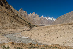 Trango tower family, Lobsang spire and river, K2 trek, Pakistan. Travel Asia Stock Photography