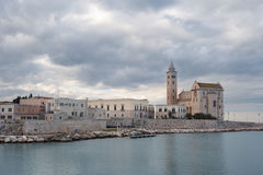 Trani (Apulia, Italy) romanesque cathedral reflecting in Mediterranean Sea Royalty Free Stock Images