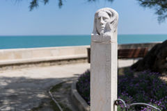 Trani statue and view on coast royalty free stock photo
