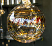 Tranparent glass Christmas ball with gold and red Royalty Free Stock Photography
