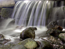 Tranquil. A small water fall and rock garden Royalty Free Stock Photos