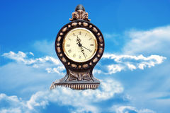 Tranquil. Clock in the clouds Stock Images