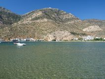 Tranquil Bay. A tranquil bay, with harsh rocky mountains in the back, Kamares, Sifnos island, Greece stock image