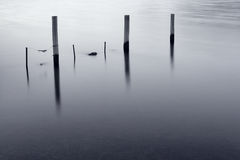 Tranquil Bay. Three old pillars in a tranquil bay Royalty Free Stock Photography