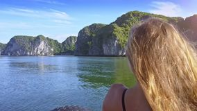 Tranquil Bay and Cliffs against Sky and Backside Girl View stock video footage