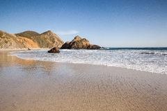 Tranquil beach in Pfeiffer state beach. Beautiful Pfeiffer stat beach in Big Sur, CA Royalty Free Stock Image