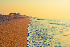 Tranquil Beach Sunrise Stock Photos