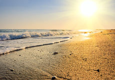 Tranquil beach sunset. On the deach of ocean Stock Photography