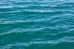 Tranquil blue green seawater wave background Stock Photo