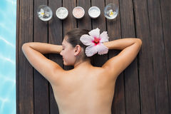 Tranquil brunette poolside with beauty treatments Stock Photography