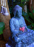 Tranquil Buddah. Statue in tropical garden royalty free stock image