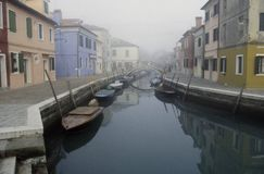 Tranquil canal streetscape in Burano, Venice, Italy Stock Photography