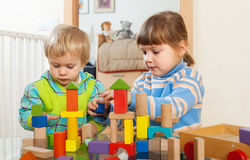Tranquil children playing with wooden toys Royalty Free Stock Photography