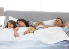 Tranquil children sleeping with their parents Royalty Free Stock Images