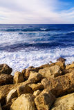 Tranquil coastline scene - rocks and sea waves Stock Image