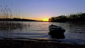 Tranquil dusk with the boat and lake stock video footage