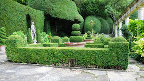 Tranquil English Garden. Tranquil Formal Garden Scene with Verdant Topiary Parterre royalty free stock photos